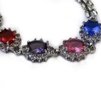 دستبند نقره ای با نگین های صورتی ، قرمز و… – مدل ۱