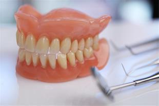 دندان مصنوعی با بیمه